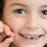 How to deal with your child's first tooth loss
